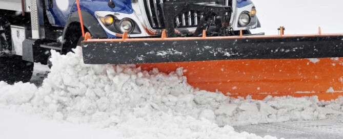 A photo of a truck removing snow.